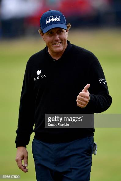 Phil Mickelson of the United States gives a thumbs up on the 18th green during the third round on day three of the 145th Open Championship at Royal...