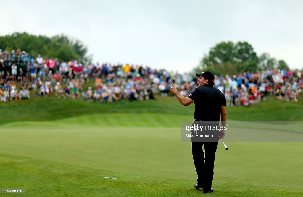 <a gi-track='captionPersonalityLinkClicked' href=/galleries/search?phrase=Phil+Mickelson&family=editorial&specificpeople=157543 ng-click='$event.stopPropagation()'>Phil Mickelson</a> of the United States gives a thumbs-up after making a putt for eagle on the 18th green during the second round of the 96th PGA Championship at Valhalla Golf Club on August 8, 2014 in Louisville, Kentucky.