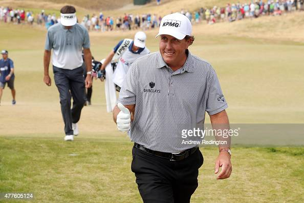 Phil Mickelson of the United States gives a thumbsup as he leaves the 11th green during the first round of the 115th US Open Championship at Chambers...