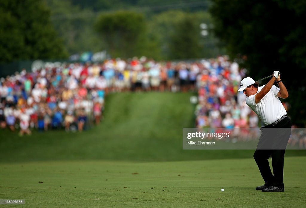 Phil Mickelson of the United States hits an approach shot on the 12th hole during the first round of the 96th PGA Championship at Valhalla Golf Club on August 7, 2014 in Louisville, Kentucky.