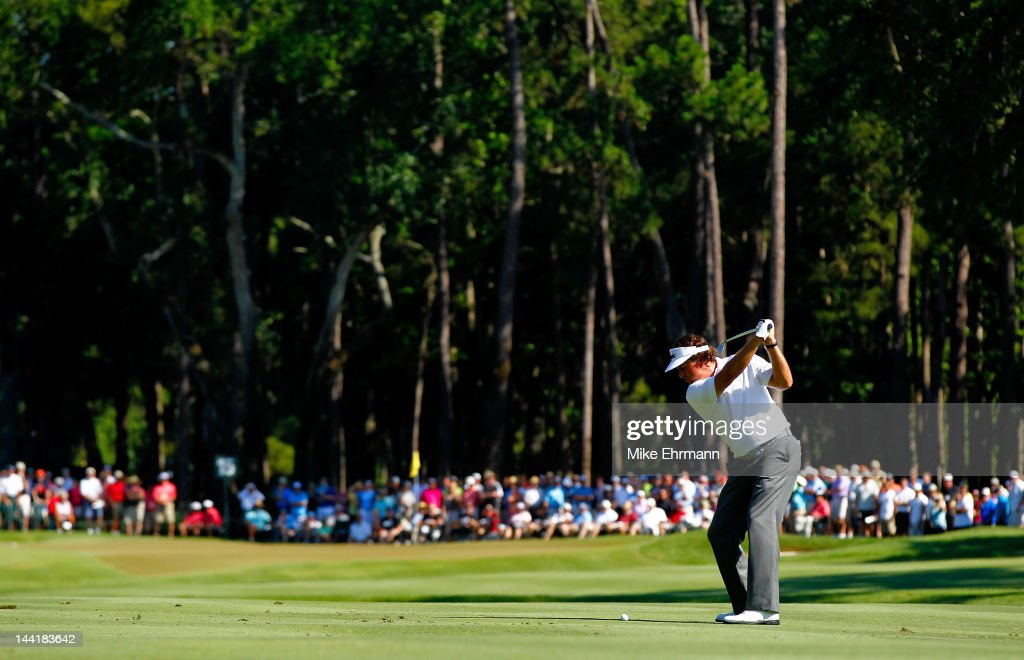<a gi-track='captionPersonalityLinkClicked' href=/galleries/search?phrase=Phil+Mickelson&family=editorial&specificpeople=157543 ng-click='$event.stopPropagation()'>Phil Mickelson</a> of the United States hits an approach shot on the 15th hole during the second round of THE PLAYERS Championship held at THE PLAYERS Stadium course at TPC Sawgrass on May 11, 2012 in Ponte Vedra Beach, Florida.