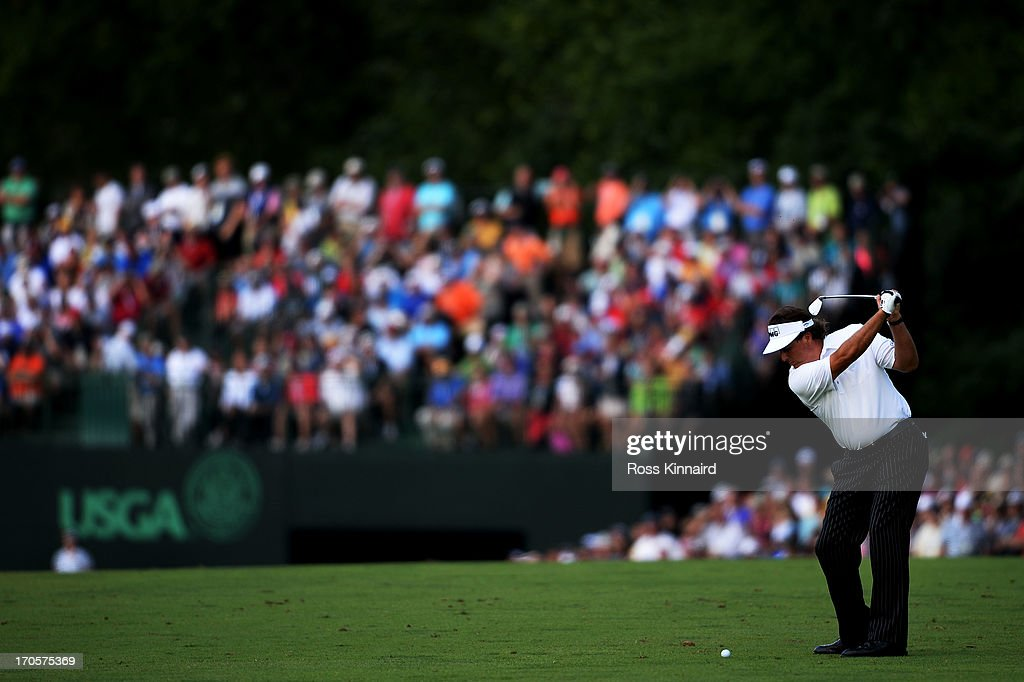 Phil Mickelson of the United States hits an approach shot on the eighth hole during Round Two of the 113th US Open at Merion Golf Club on June 14...