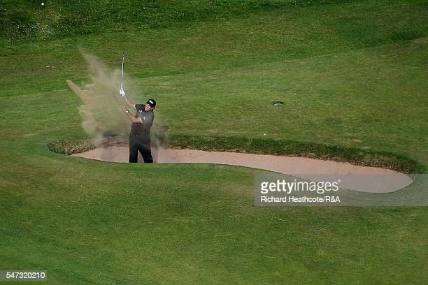 Phil Mickelson of the United States hits from a bunker on the 16th hole during the first round on day one of the 145th Open Championship at Royal...