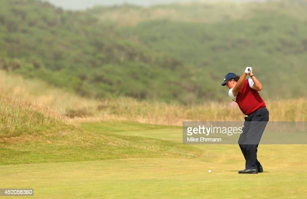 Phil Mickelson of the United States hits his approach shot on the first hole during the third round of the 2014 Aberdeen Asset Management Scottish...