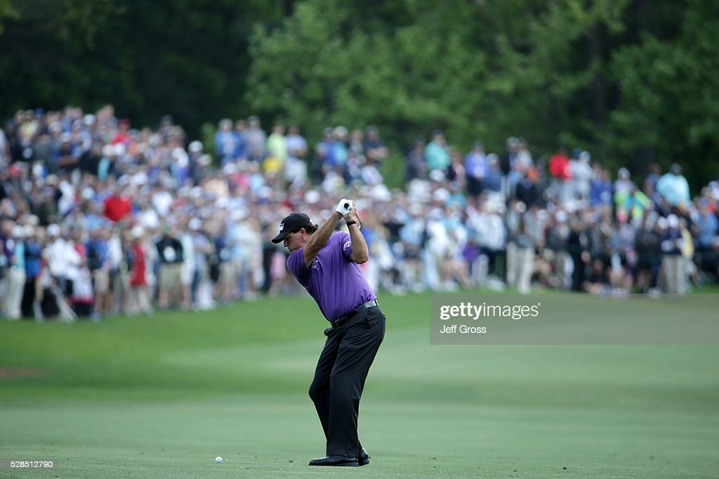 Phil Mickelson of the United States hits his approach shot on the seventh hole during the first round of the Wells Fargo Championship at Quail Hollow on May 5, 2016 in Charlotte, North Carolina.
