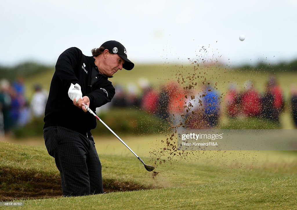 Phil Mickelson of the United States hits his second shot on the 16th hole from a bunker during the third round of the 144th Open Championship at The Old Course on July 19, 2015 in St Andrews, Scotland.