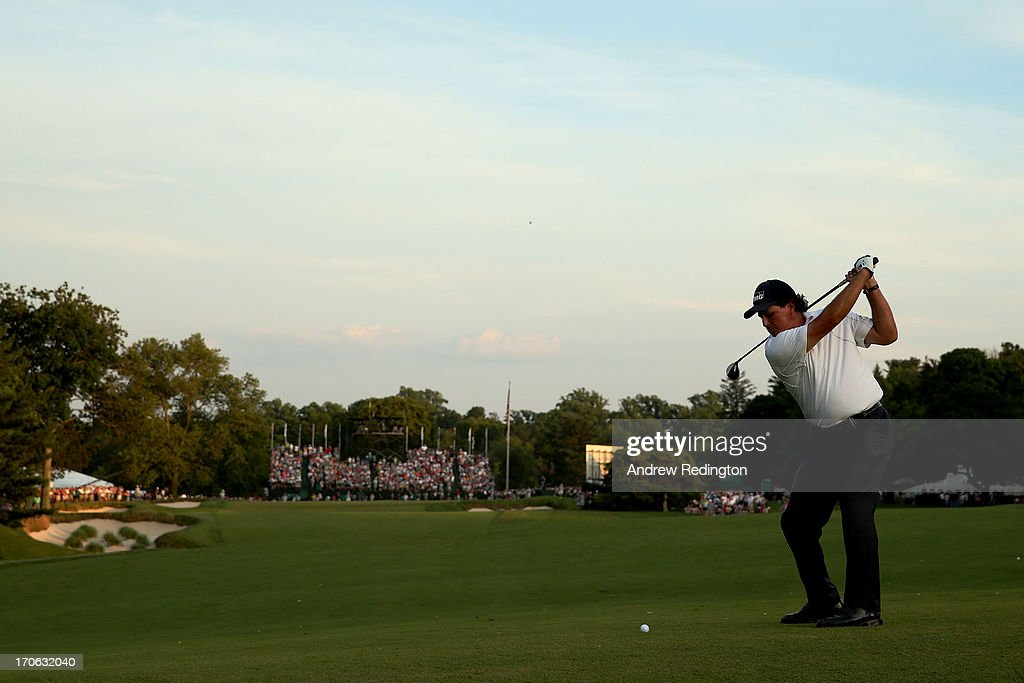 <a gi-track='captionPersonalityLinkClicked' href=/galleries/search?phrase=Phil+Mickelson&family=editorial&specificpeople=157543 ng-click='$event.stopPropagation()'>Phil Mickelson</a> of the United States hits his second shot on the 18th hole during Round Three of the 113th U.S. Open at Merion Golf Club on June 15, 2013 in Ardmore, Pennsylvania.