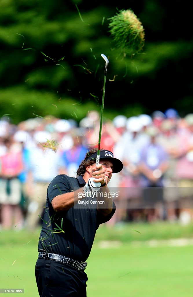 Phil Mickelson of the United States hits his second shot on the first hole during the final round of the 113th US Open at Merion Golf Club on June 16...