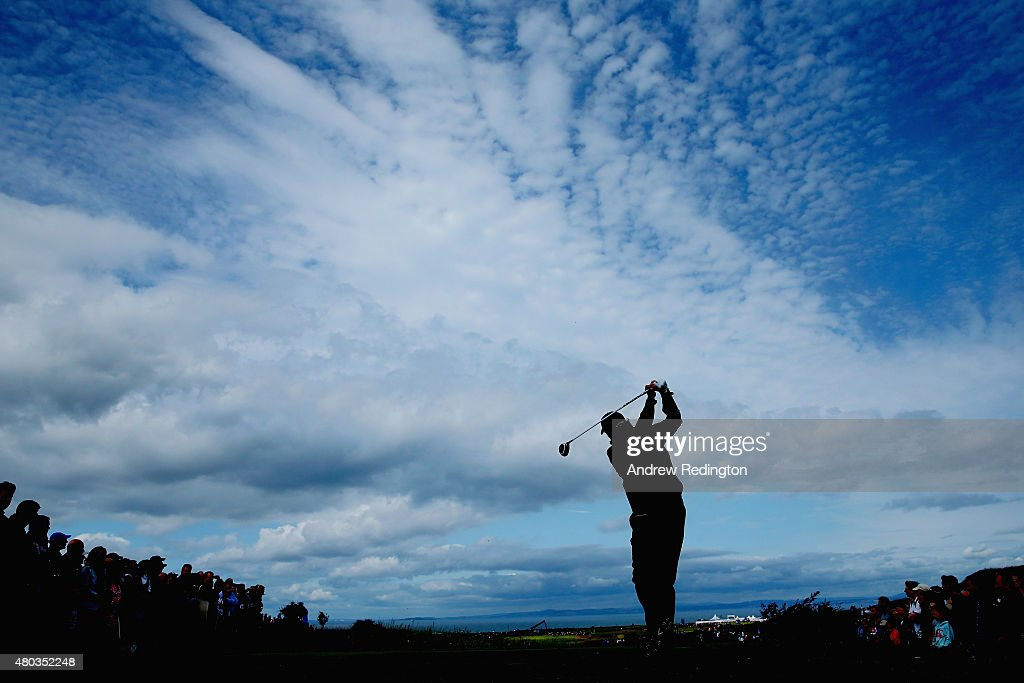 Phil Mickelson of the United States hits his tee shot on the second hole as a gallery of fans look on during the third round of the Aberdeen Asset...
