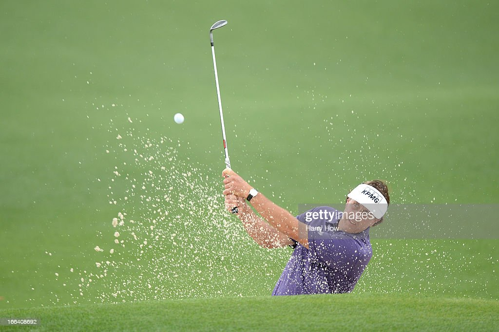 Phil Mickelson of the United States hits out of the bunker on the second hole during the second round of the 2013 Masters Tournament at Augusta National Golf Club on April 12, 2013 in Augusta, Georgia.