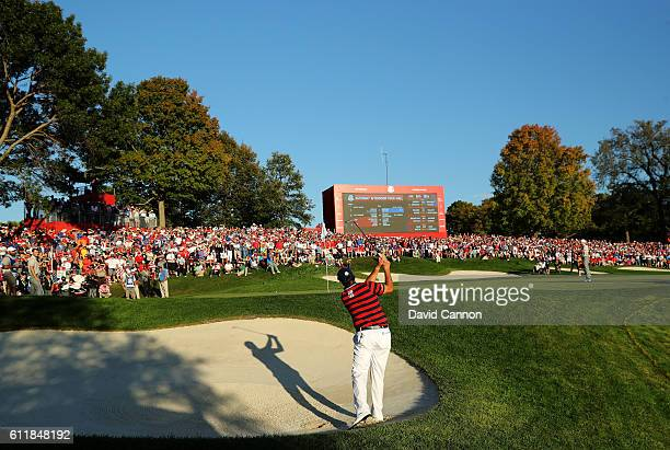 Phil Mickelson of the United States hits out of the bunker on the 16th hole during afternoon fourball matches of the 2016 Ryder Cup at Hazeltine...