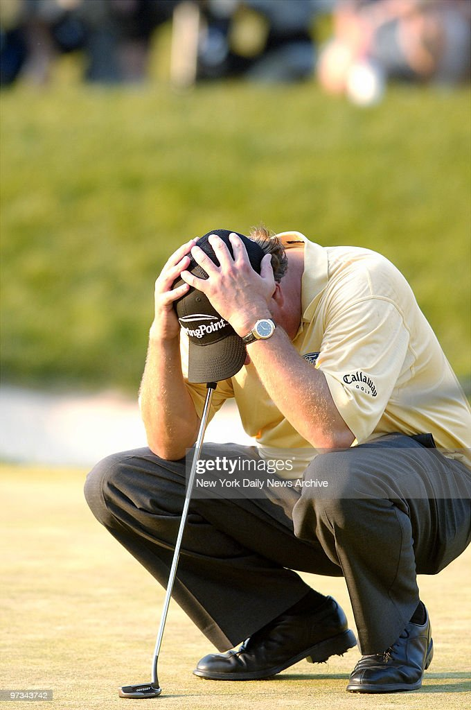 Phil Mickelson of the United States holds his head as he loses the lead at the 18th hole during the final round of the 2006 US Open Championship at...