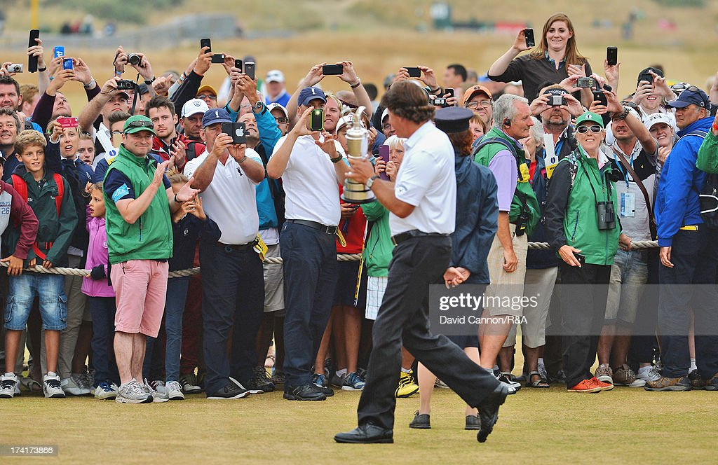 <a gi-track='captionPersonalityLinkClicked' href=/galleries/search?phrase=Phil+Mickelson&family=editorial&specificpeople=157543 ng-click='$event.stopPropagation()'>Phil Mickelson</a> of the United States holds the Claret Jug after winning the 142nd Open Championship at Muirfield on July 21, 2013 in Gullane, Scotland.
