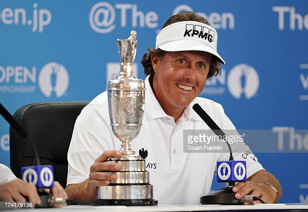 Phil Mickelson of the United States holds the Claret Jug as he answers questions after winning the 142nd Open Championship at Muirfield on July 21...