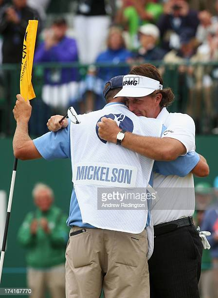 Phil Mickelson of the United States hugs his caddie Jim Mackay after completing his final round of the 142nd Open Championship at Muirfield on July...