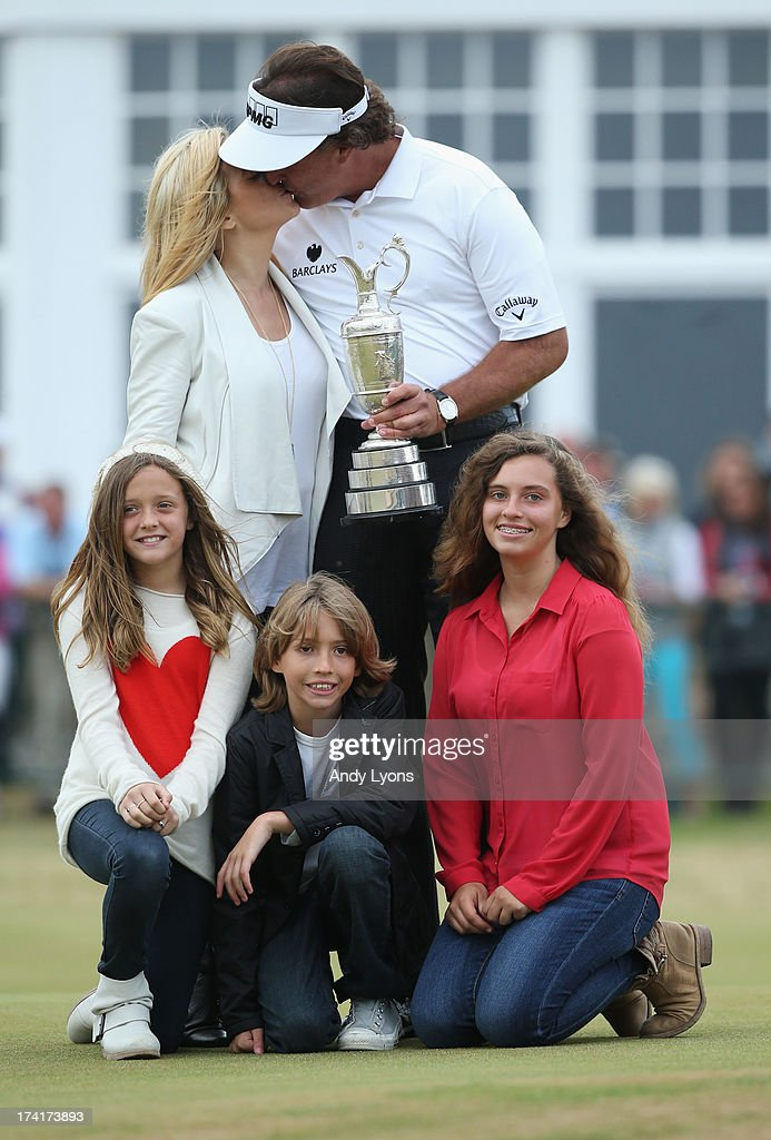 <a gi-track='captionPersonalityLinkClicked' href=/galleries/search?phrase=Phil+Mickelson&family=editorial&specificpeople=157543 ng-click='$event.stopPropagation()'>Phil Mickelson</a> of the United States kisses wife Amy with children Evan, Amanda and Sophia after winning the 142nd Open Championship at Muirfield on July 21, 2013 in Gullane, Scotland.