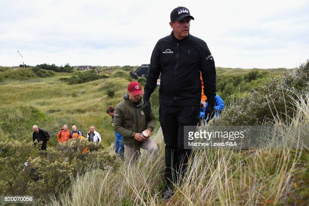 Phil Mickelson of the United States looks for his ball on the 3rd hole during the second round of the 146th Open Championship at Royal Birkdale on...