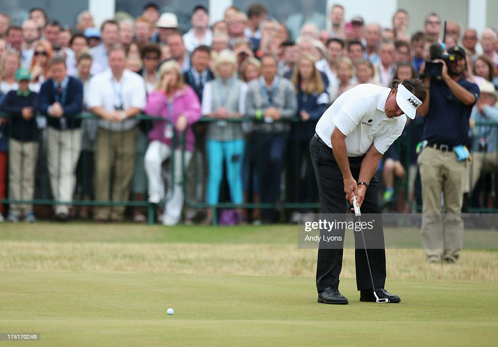 Phil Mickelson of the United States makes a birdie putt on the 18th green during the final round of the 142nd Open Championship at Muirfield on July...