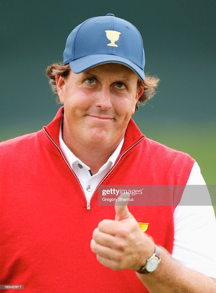Phil Mickelson of the United States of the U.S. Team walks across a green during the Day Four Singles Matches at the Muirfield Village Golf Club on October 6, 2013 in Dublin, Ohio.