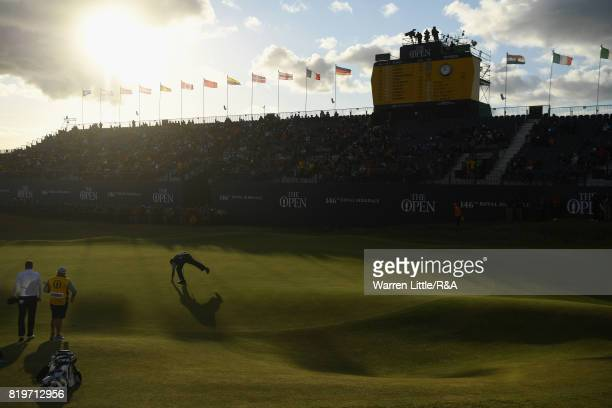 Phil Mickelson of the United States picks his ball from the hole on the 18th green during the first round of the 146th Open Championship at Royal...