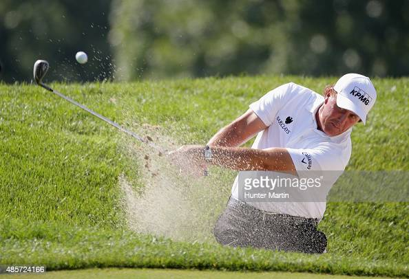 Phil Mickelson of the United States plays a bunker on the first hole during the third round of The Barclays at Plainfield Country Club on August 29...