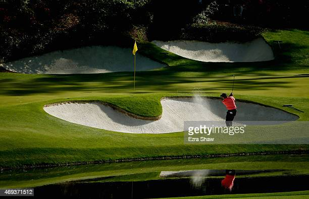 Phil Mickelson of the United States plays a bunker shot on the 12th hole during the third round of the 2015 Masters Tournament at Augusta National...