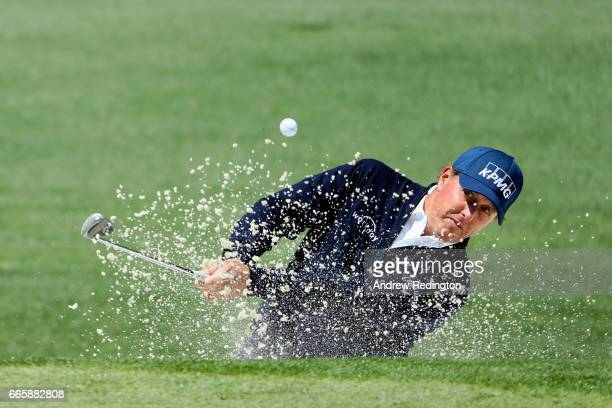 Phil Mickelson of the United States plays a shot from a bunker on the second hole during the second round of the 2017 Masters Tournament at Augusta...