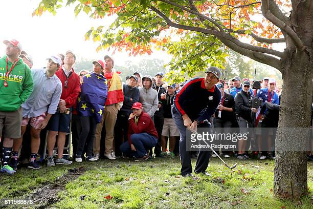 Phil Mickelson of the United States plays a shot from under a tree on the 11th hole during morning foursome matches of the 2016 Ryder Cup at...