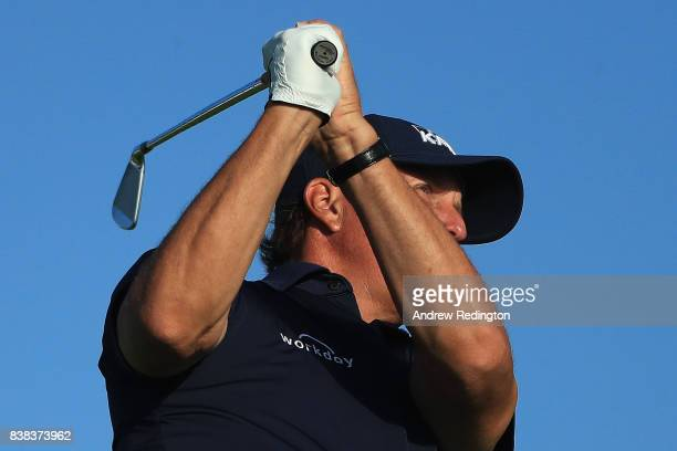 Phil Mickelson of the United States plays his shot from the 11th tee during round one of The Northern Trust at Glen Oaks Club on August 24 2017 in...