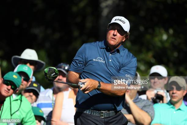 Phil Mickelson of the United States plays his shot from the ninth tee during a practice round prior to the start of the 2017 Masters Tournament at...