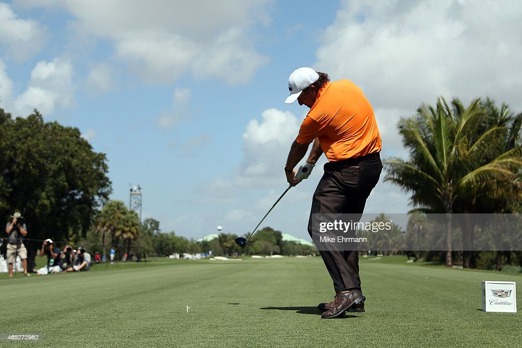 Phil Mickelson of the United States plays his tee shot on the twelfth hole during the first round of the World Golf ChampionshipsCadillac...