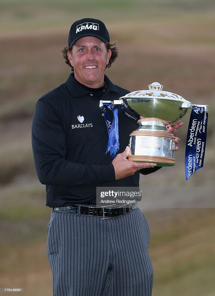 <a gi-track='captionPersonalityLinkClicked' href=/galleries/search?phrase=Phil+Mickelson&family=editorial&specificpeople=157543 ng-click='$event.stopPropagation()'>Phil Mickelson</a> of the United States poses with the trophy after his victory on the 1st hole of a sudden-death playoff during the final round of the Aberdeen Asset Management Scottish Open at Castle Stuart Golf Links on July 14, 2013 in Inverness, Scotland.