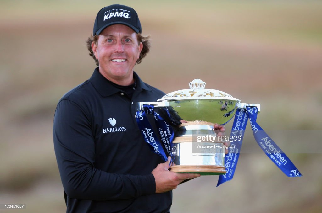 Phil Mickelson of the United States poses with the trophy after his victory on the 1st hole of a sudden-death playoff during the final round of the Aberdeen Asset Management Scottish Open at Castle Stuart Golf Links on July 14, 2013 in Inverness, Scotland.
