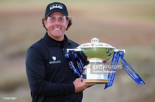 Phil Mickelson of the United States poses with the trophy after his victory on the 1st hole of a suddendeath playoff during the final round of the...
