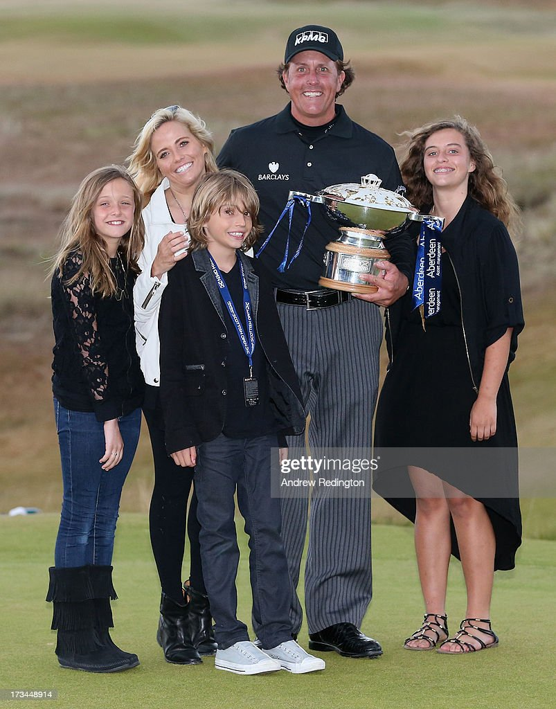 <a gi-track='captionPersonalityLinkClicked' href=/galleries/search?phrase=Phil+Mickelson&family=editorial&specificpeople=157543 ng-click='$event.stopPropagation()'>Phil Mickelson</a> of the United States poses with the trophy and his wife Amy and children Evan, Amanda (R) and Sophia after his victory on the 1st hole of a sudden-death playoff during the final round of the Aberdeen Asset Management Scottish Open at Castle Stuart Golf Links on July 14, 2013 in Inverness, Scotland.