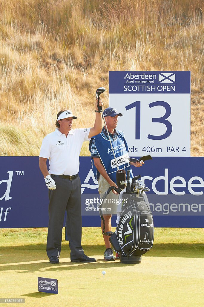 Phil Mickelson of the United States pulls a club during the first round of the Aberdeen Asset Management Scottish Open at Castle Stuart Golf Links on July 11, 2013 in Inverness, Scotland.