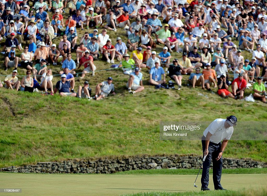 Phil Mickelson of the United States putts on the ninth hole during Round Three of the 113th U.S. Open at Merion Golf Club on June 15, 2013 in Ardmore, Pennsylvania.