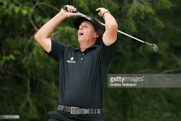 Phil Mickelson of the United States reacts after chipping to the second green during the final round of the 113th US Open at Merion Golf Club on June...