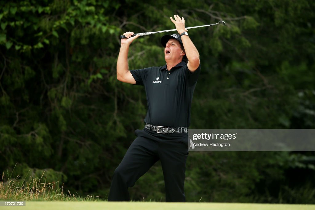 <a gi-track='captionPersonalityLinkClicked' href=/galleries/search?phrase=Phil+Mickelson&family=editorial&specificpeople=157543 ng-click='$event.stopPropagation()'>Phil Mickelson</a> of the United States reacts after chipping to the second green during the final round of the 113th U.S. Open at Merion Golf Club on June 16, 2013 in Ardmore, Pennsylvania.