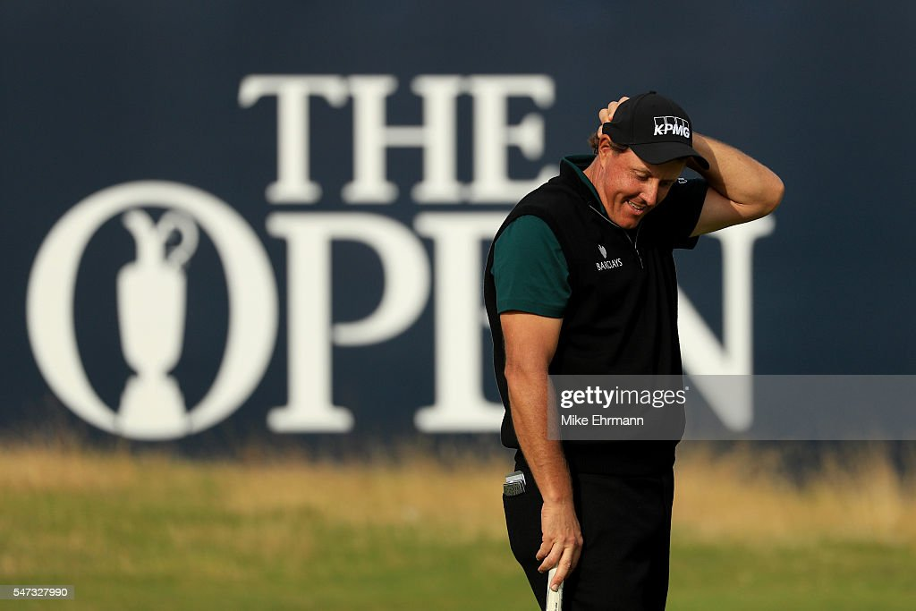 Phil Mickelson of the United States reacts after his birdie putt narrowly missed the hole on the 18th during the first round on day one of the 145th Open Championship at Royal Troon on July 14, 2016 in Troon, Scotland.