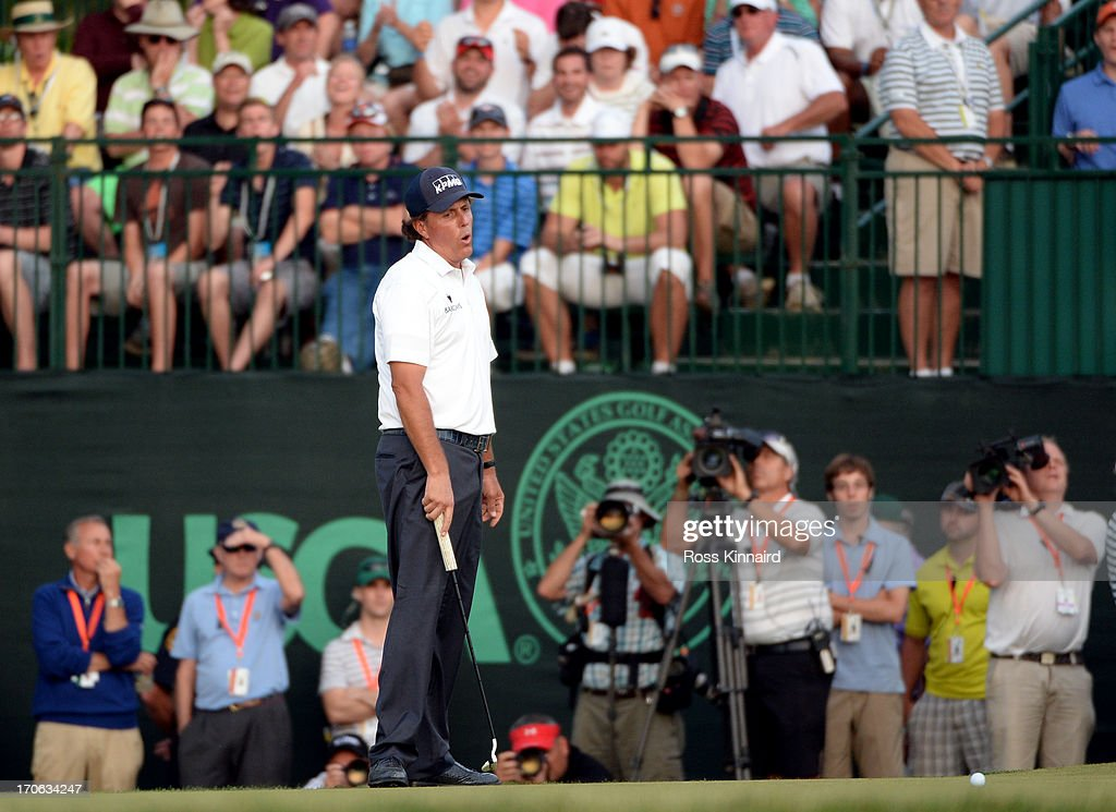 Phil Mickelson of the United States reacts after making a putt for bogey on the 18th hole during Round Three of the 113th U.S. Open at Merion Golf Club on June 15, 2013 in Ardmore, Pennsylvania.