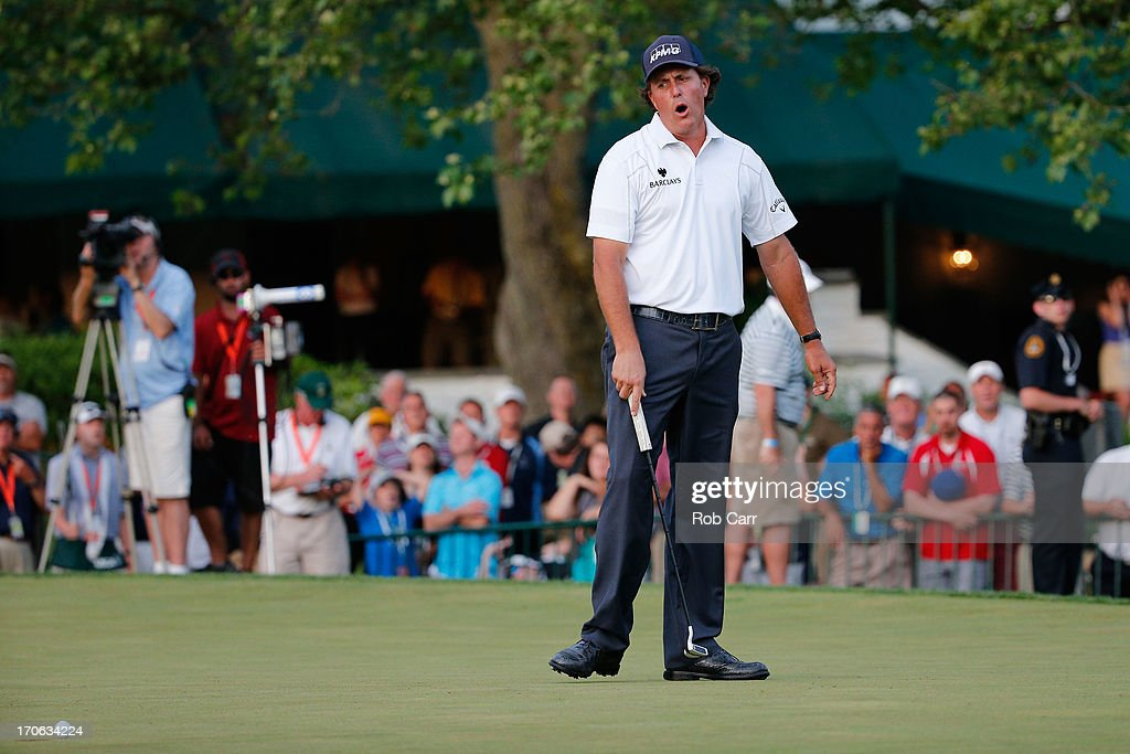 Phil Mickelson of the United States reacts on the 18th green during Round Three of the 113th U.S. Open at Merion Golf Club on June 15, 2013 in Ardmore, Pennsylvania.