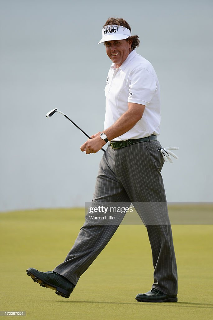 <a gi-track='captionPersonalityLinkClicked' href=/galleries/search?phrase=Phil+Mickelson&family=editorial&specificpeople=157543 ng-click='$event.stopPropagation()'>Phil Mickelson</a> of the United States reacts to a birdie putt on the 18th green during the third round of the Aberdeen Asset Management Scottish Open at Castle Stuart Golf Links on July 13, 2013 in Inverness, Scotland.