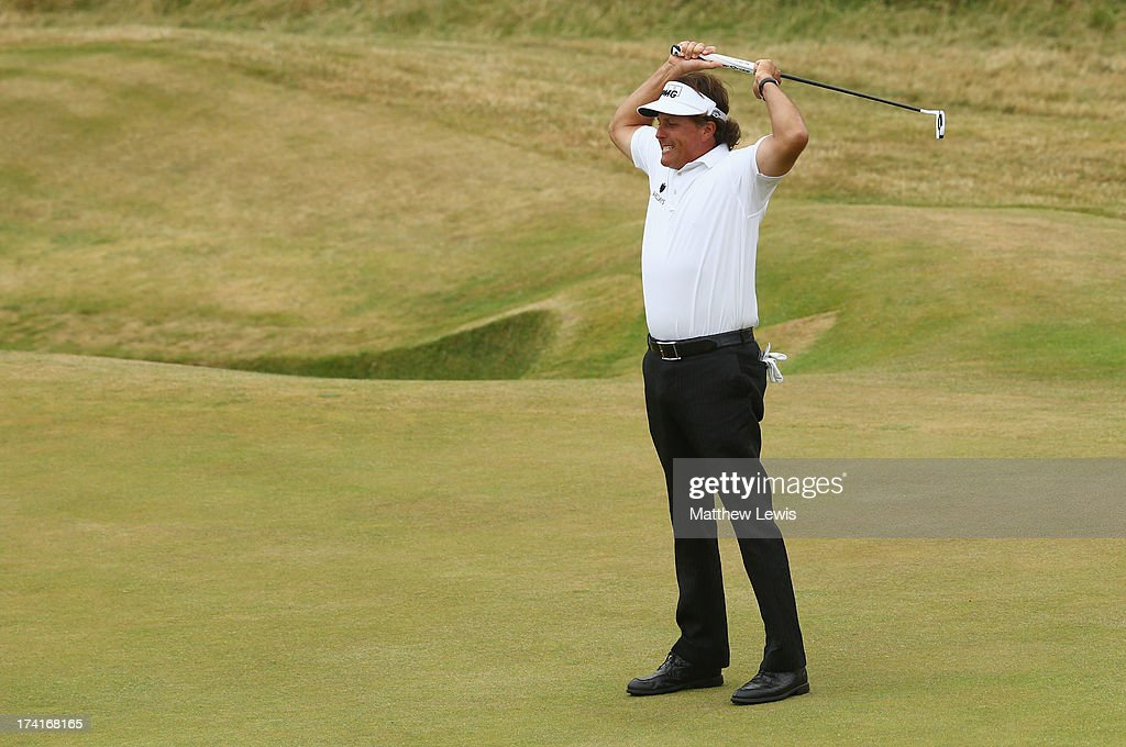 Phil Mickelson of the United States reacts to a birdie putt on the 18th hole during the final round of the 142nd Open Championship at Muirfield on July 21, 2013 in Gullane, Scotland.