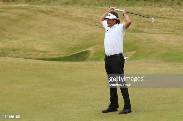 Phil Mickelson of the United States reacts to a birdie putt on the 18th hole during the final round of the 142nd Open Championship at Muirfield on...