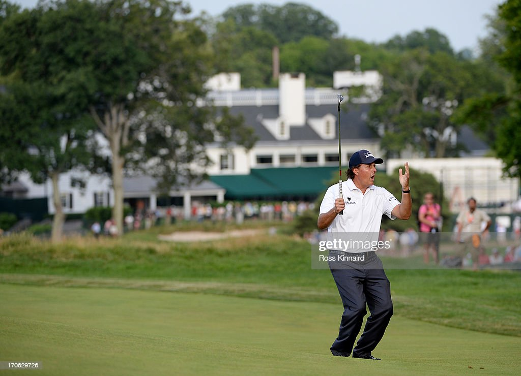 Phil Mickelson of the United States reacts to a putt on the 14th green during Round Three of the 113th U.S. Open at Merion Golf Club on June 15, 2013 in Ardmore, Pennsylvania.