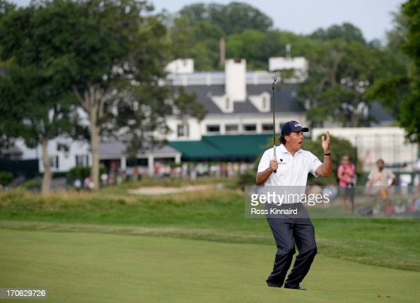 Phil Mickelson of the United States reacts to a putt on the 14th green during Round Three of the 113th US Open at Merion Golf Club on June 15 2013 in...