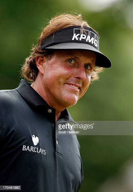 Phil Mickelson of the United States reacts to his birdie on the seventh hole during Round One of the 113th US Open at Merion Golf Club on June 13...