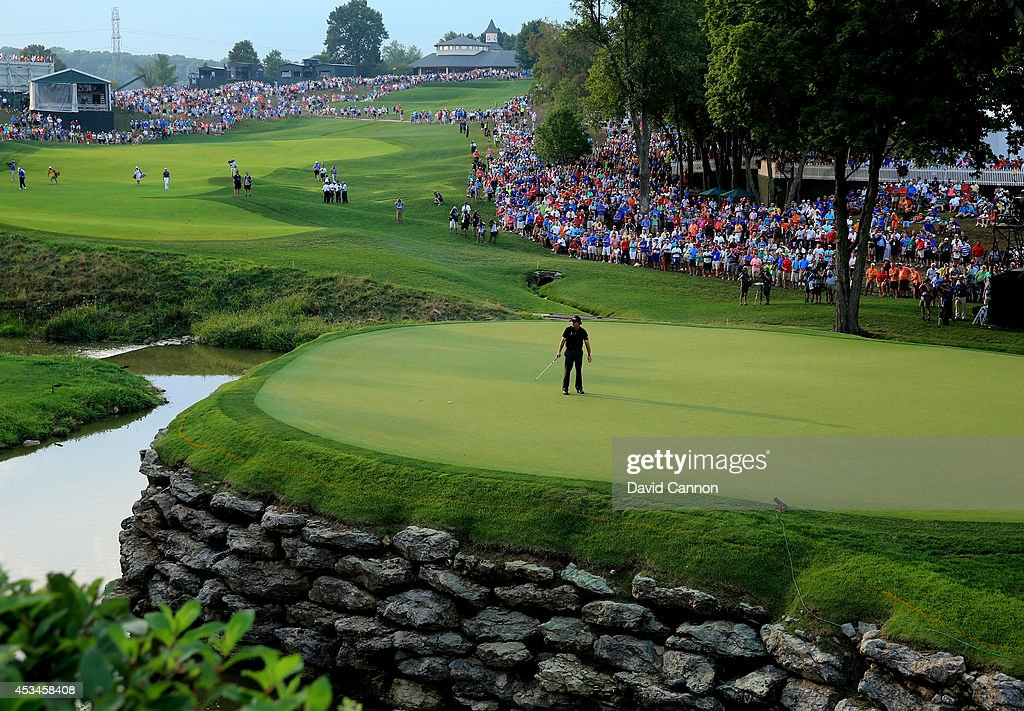 Phil Mickelson of the United States reacts to making a putt for birdie on the 13th green during the final round of the 96th PGA Championship at...