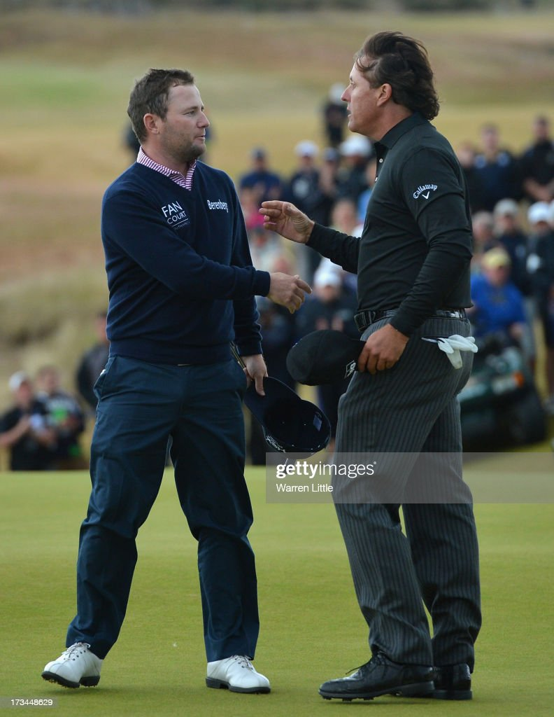 <a gi-track='captionPersonalityLinkClicked' href=/galleries/search?phrase=Phil+Mickelson&family=editorial&specificpeople=157543 ng-click='$event.stopPropagation()'>Phil Mickelson</a> of the United States (R) shakes hands with <a gi-track='captionPersonalityLinkClicked' href=/galleries/search?phrase=Branden+Grace&family=editorial&specificpeople=4816558 ng-click='$event.stopPropagation()'>Branden Grace</a> of South Africa on the 18th green after his victory on the 1st hole of a sudden-death playoff during the final round of the Aberdeen Asset Management Scottish Open at Castle Stuart Golf Links on July 14, 2013 in Inverness, Scotland.